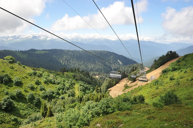 View of caucasus mountains from the open seats of the cable car in the summe