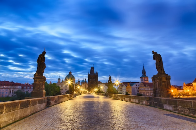 View of charles bridge in prague with blue sky and clouds, czech republic during blue hour sunrise