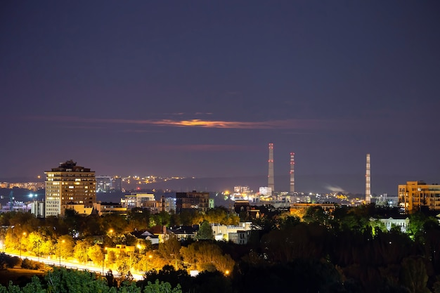 View of chisinau at night at long exposure, street with light traces, a lot of greenery, residential buildings, moldova