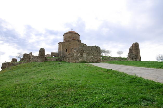 View of the church jvari on the background of the spring sky
