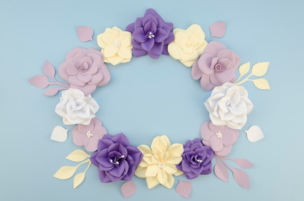 Above view circular frame with beautiful paper flowers