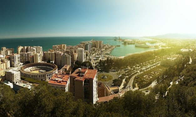 View of the city of malaga, with the bullring of la malagueta and the port