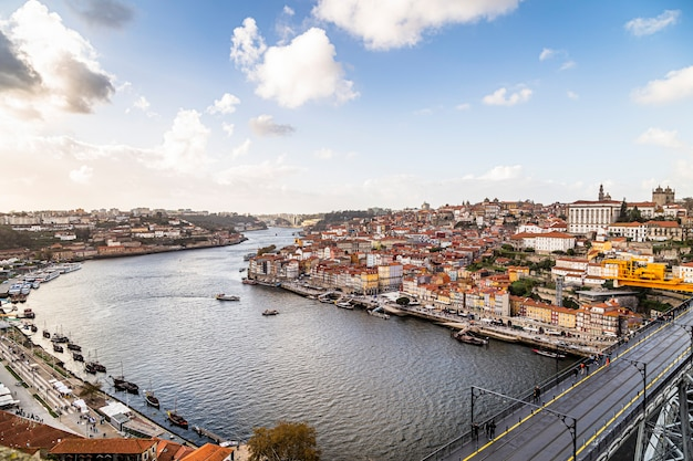 View of the city of porto seen by the city vila nova de gaia in portugal, luis iv bridge, douro river and por do sol. november 05, 2019
