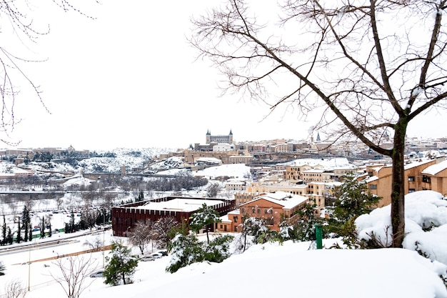 View of the city of toledo in the snow.
