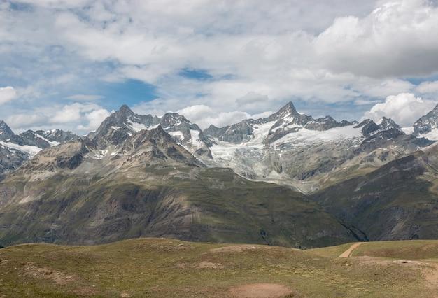 View closeup mountains scene in national park zermatt, switzerland, europe. summer landscape, sunshine weather, dramatic blue sky and sunny day