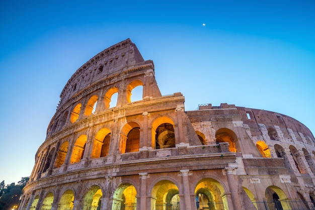 View of colosseum in rome at twilight, italy, europe.