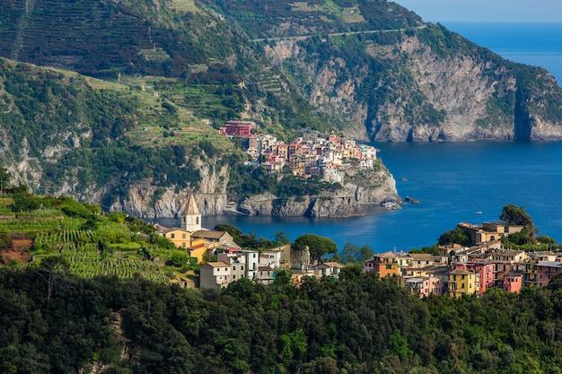 View of corniglia and manarola, colorful villages of cinque terre, italy.