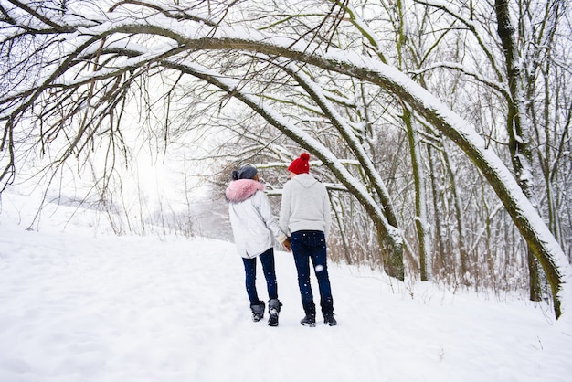 View of couple in love from the back in winter outdoors