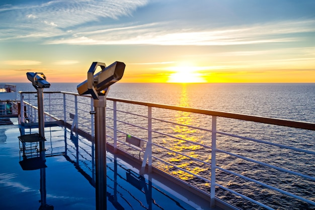 View of cruise liner deck, ocean and sunrise