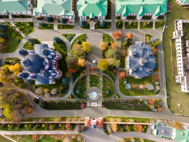 View of the curchi monastery from the drone. churches, other buildings, green lawns and walk paths. moldova