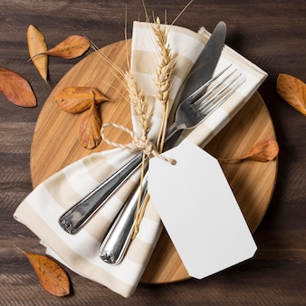 Above view cutlery with autumn leaves