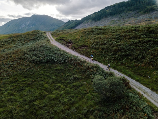 View of cyclists in glen etive