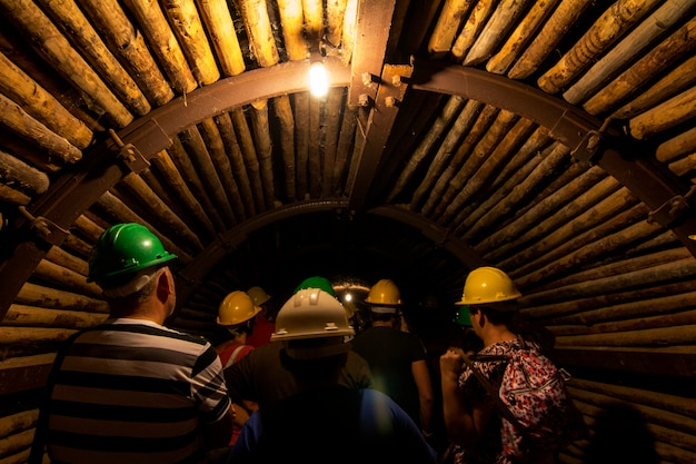 View of a dark eerie mining tunnel with tourists.