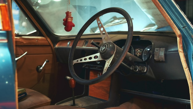 View of dashboard panel and steering wheel of antique car triumph