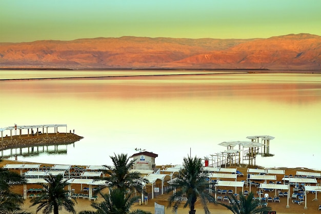 View of dead sea coastline at sunset