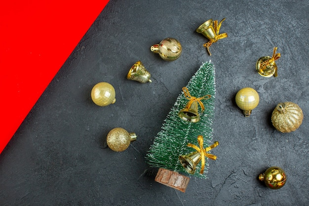 Above view of decoration accessories and christmas tree on dark background