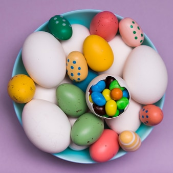 Above view decoration with colorful eggs and candy