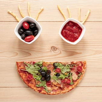 Above view decoration with pizza and sauce
