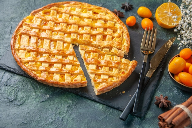 Above view delicious kumquat pie with sliced one piece on dark surface dessert sweet bake cookie cake dough oven biscuit color tea