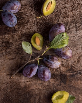 Above view delicious plums arrangement