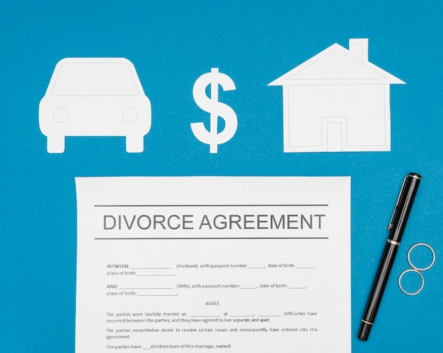Above view divorce agreement with pen