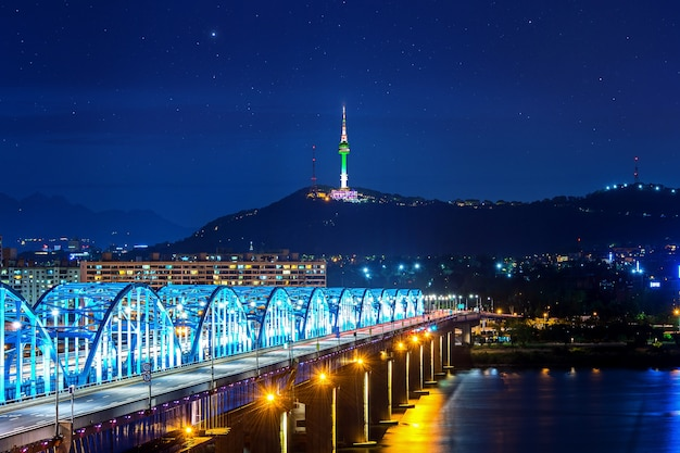 View of downtown cityscape at dongjak bridge and seoul tower over han river in seoul, south korea