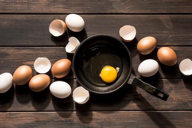 Above view eggs on wooden background