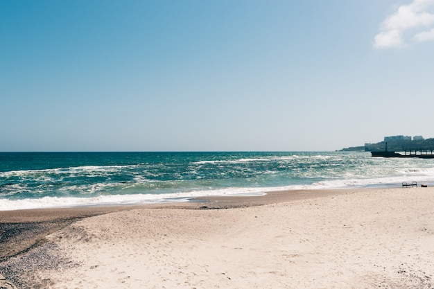 View of an empty beach on a sunny day