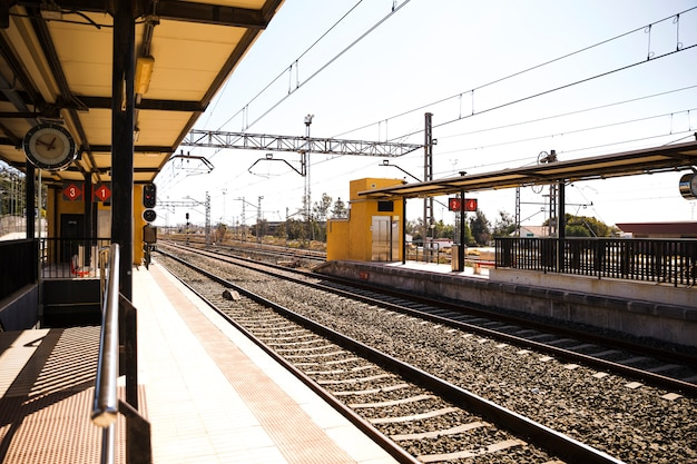 View of empty railway station with railroad