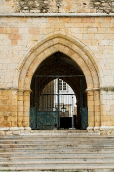 View of the entry arch of the church of se located in portugal, europe.
