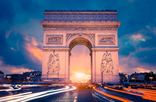 View of famous arc de triomphe at sunset, paris