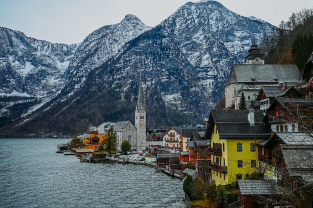 View of famous hallstatt mountain village and alpine lake