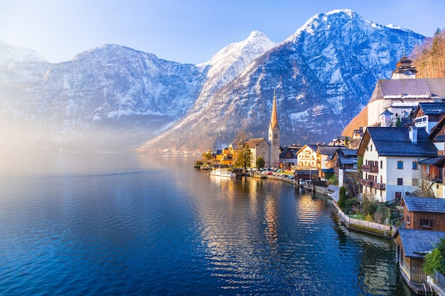 View of famous hallstatt town with lake and mountains seen in one beautiful morning