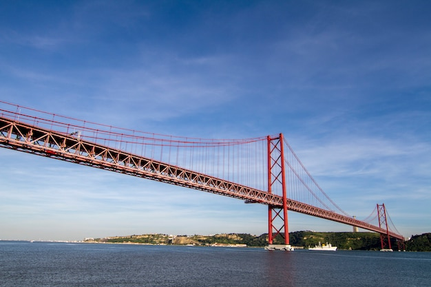 View of the famous portuguese bridge over the tagus river located in lisbon, portugal.