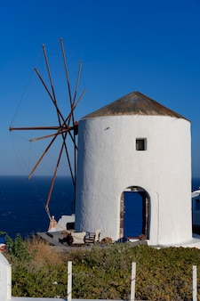 View of famous windmill in oia, santorini, greece