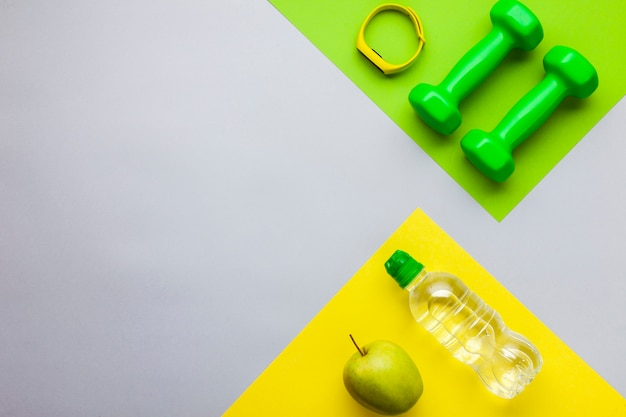 Above view fitness equipment and water bottle