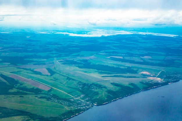 View from airplane on earth surface - river. the volga river