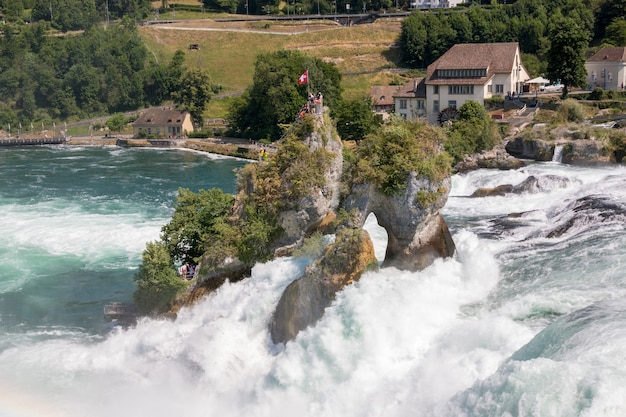 View from castle laufen on rhine falls is the largest waterfall in schaffhausen, switzerland. summer landscape, sunshine weather, blue sky and sunny day