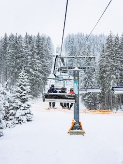 View from chairlift at ski resort copy space