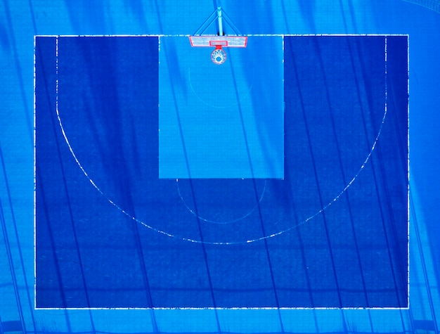 View from the drone on the basketball court with a blue coating, artificial turf.