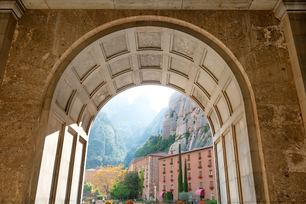 View from the entrance of famous montserrat monastery to buildings and mountain