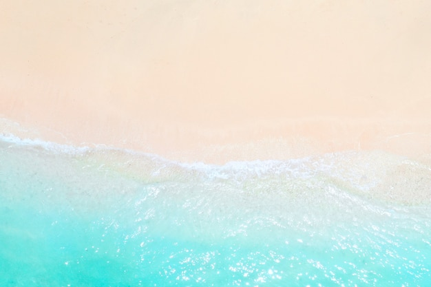 A view from a height of a tropical beach and waves breaking on a tropical golden sandy beach. the sea waves gently wind along the beautiful sandy beach.