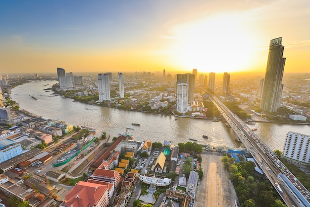 View from high building, bangkok capital city of thailand at twilight. traffic and transportation on road and river