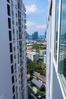 View from the high floor of the streets of bangkok. tall buildings and roofs of small houses. city landscape