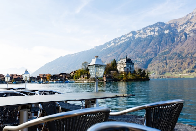 View from hotel or restaurant veranda in the swiss alps. fantastic mountain view. jungfrau region. empty table in cafe in interlaken