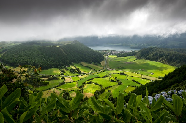 View from mountains of the valley and lake sete cidades one day with clouds and sun. sao miguel. azores portugal