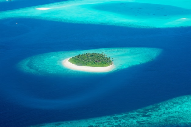 View from the plane on the island located in the maldives