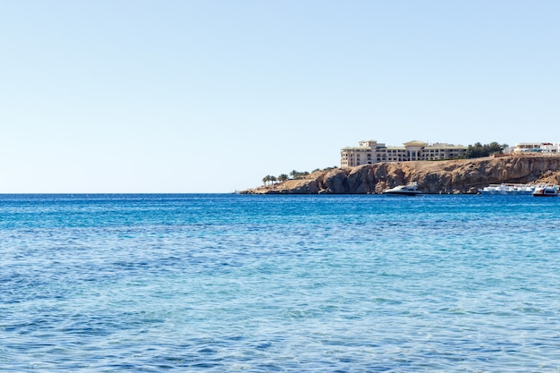 View from sea to the hotel on mountain, red sea