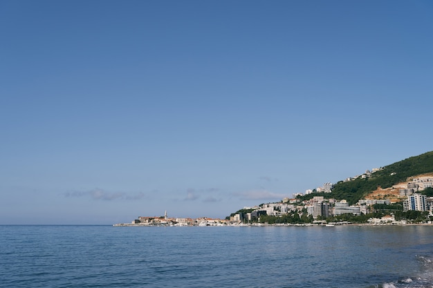View from the sea to houses in the mountains