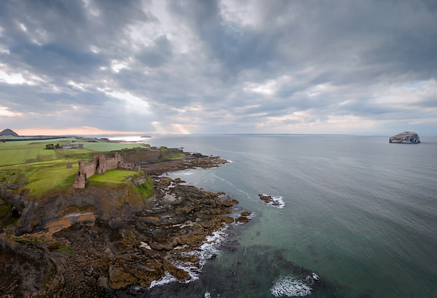 View from above on tantallon castle and bass rock at sunset. north berwick. scotland, uk